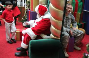 soldier behind santa